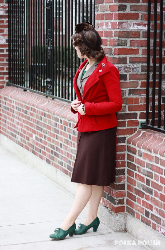 Vintage holiday outfit with a brown suit, fur 1940s tilt hat, green shoes, and red coat