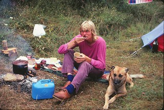 Hiker with Dog having a bite to eat, Austria, 1980
