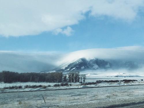 Snowy range peeking out of its fog