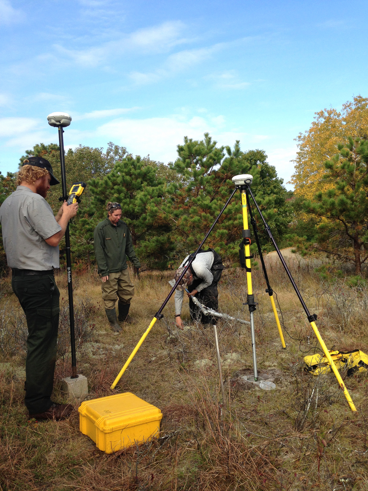 """A group of trained NPS technicians and scientists traditionally works together to consolidate all available resources, including expertise and equipment, and conduct intensive elevation surveys throughout NCBN parks. In this way, they expedite data collection in key areas of concern. They call themselves a """"GPS SWAT Team."""" NPS photo/D.Filippini."""