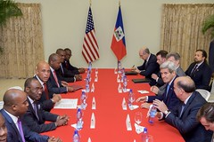 U.S. Secretary of State John Kerry, with U.S. Ambassador to Haiti Peter Mulrean, meets with Haitian President Michel Martelly and Haitian Prime Minister Evans Paul at the Presidential Palace in Port-au-Prince, Haiti, on October 6, 2015. [State Department photo/ Public Domain]