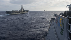 USS Chancellorsville (CG 62), right, and USS Ronald Reagan (CVN 76) approach USNS Wally Schirra (T-AKE 8) in the Philippine Sea Nov. 15 before a replenishment at sea. (U.S. Navy/MC2 Raymond D. Diaz III)
