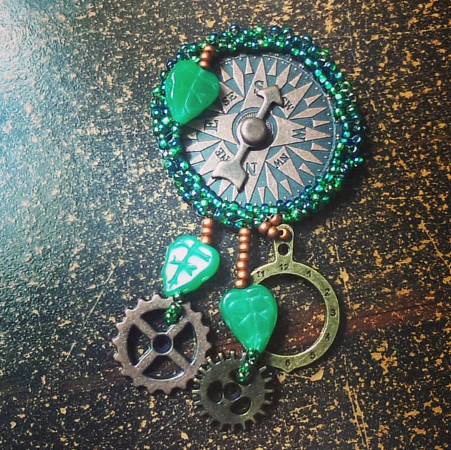 Clockwork Compass brooches, in progress   Needs a pinback and the suede cover, then this one is finished.   #clockwork #steampunk #beadwork #handbeaded #pin #brooch #handmade #mysticon #dantesspirit