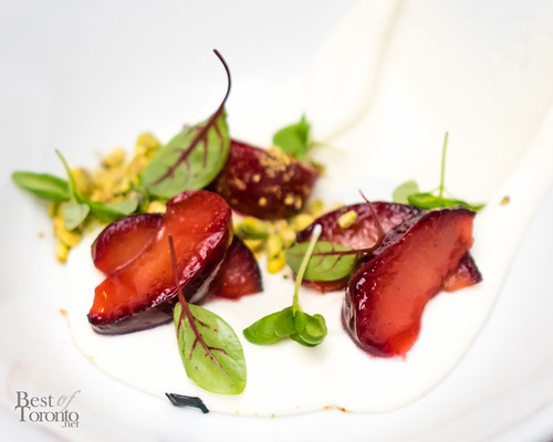 Whipped house-made ricotta with spice roasted plums, pistachios