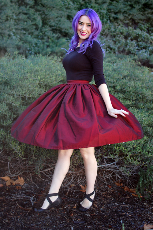 Pinup Girl Clothing Pinup Couture Jenny Skirt in Red Sharksin Taffeta Laura Byrnes Sabrina Top in Black Deer Arrow Brooch