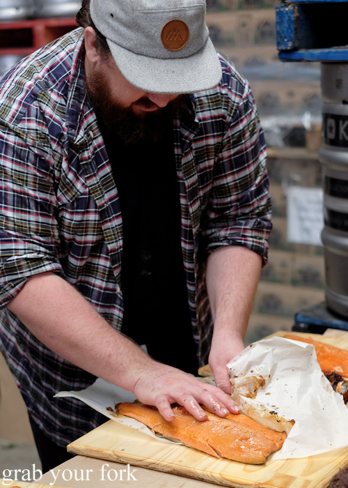 Mike Eggert plating the roasted wild brown trout at the Feral Party by Pinbone at Young Henrys for Good Food Month 2015