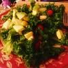 Super salad: kale,avocados,tomatoes,olives,apples with peach vinaigrette