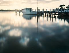White Boat on a Pier at Sunrise