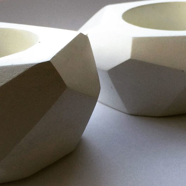 Candle holders made from air dry clay. I love the play of light across the angles.