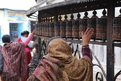 Women turn the prayer wheels in Swayambhunath Stupa where religious ceremonies have been taking place for over 2,000 years. Thank you @onthegotours for helping make this such a fun adventure. #travel #nepal #unesco