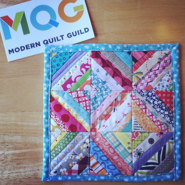 "My entry for the #fcmqgsupertinymini challenge. It measures 7.5"" sq. I was pretty excited to receive a #mqg sticker for participating. It's going to look awesome on my sewing machine."