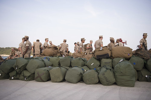OKINAWA, Japan - Members of the 31st Marine Expeditionary Unit (MEU) prepare their sea bags, load bearing equipment and rucksacks while offloading from USS Green Bay (LPD 20).