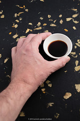 Human hand with a bowl of soy sauce (also called s…
