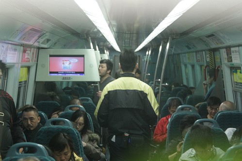 MTR staff check for tickets in the first class carriage