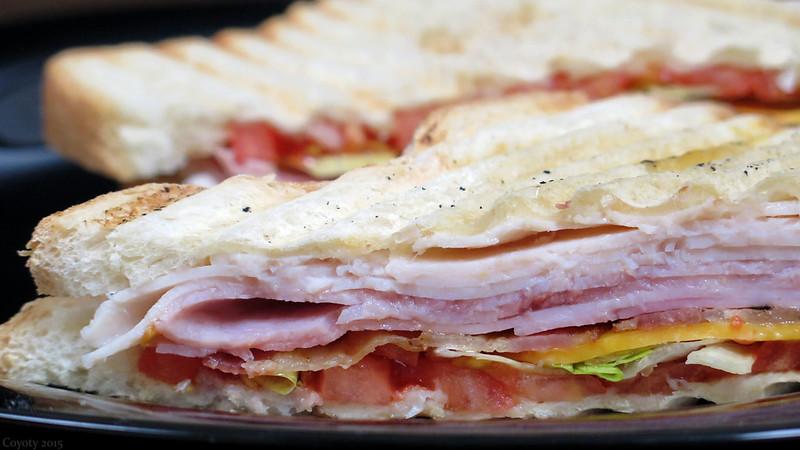 Turkey ham bacon cheddar lettuce tomato panini