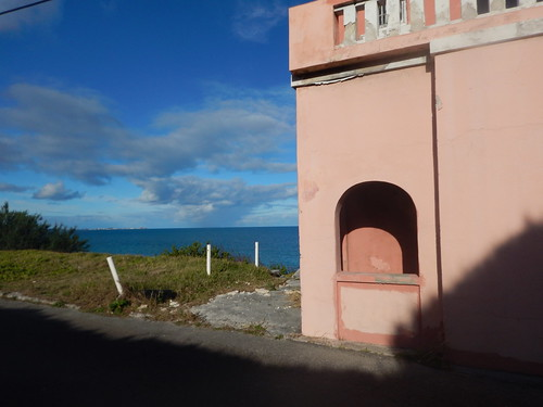 Pink house and blue ocean.