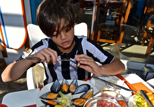 eating mussels - Day Trips From Malaga