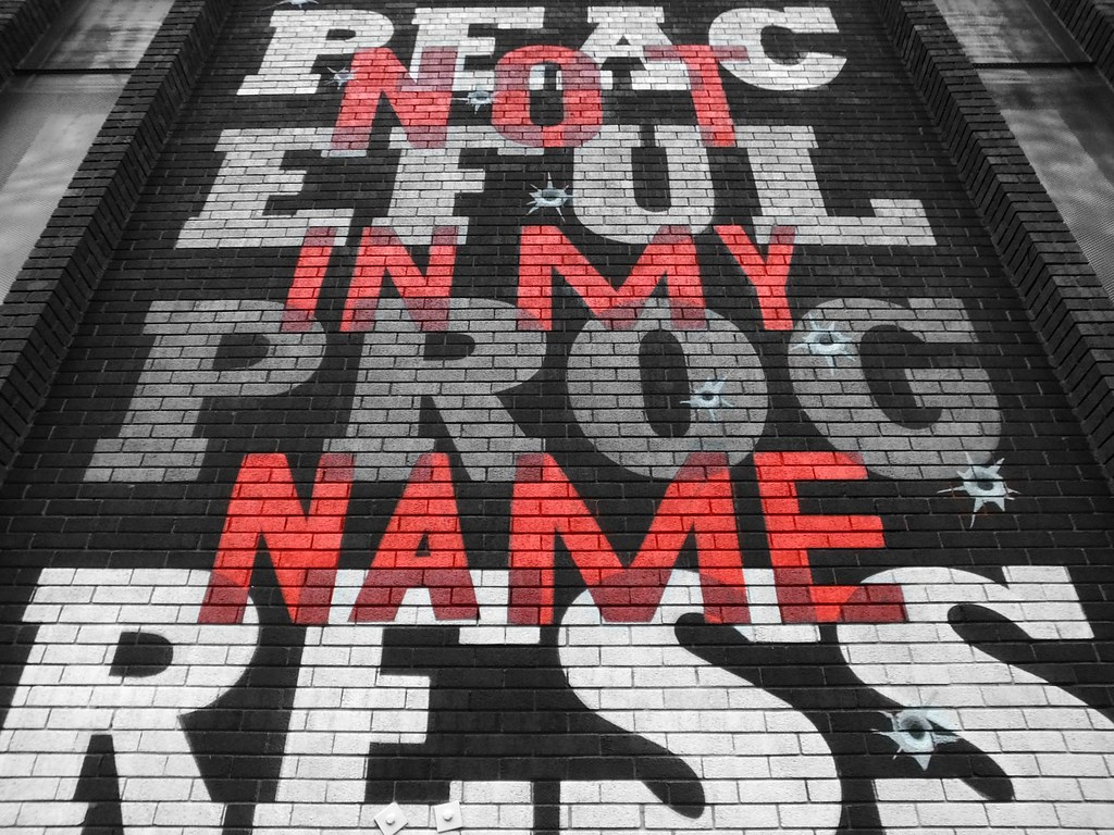 Street art: Not in my name by Peaceful Progress
