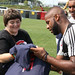 Andrew Farrell signs an autograph at Revs Training