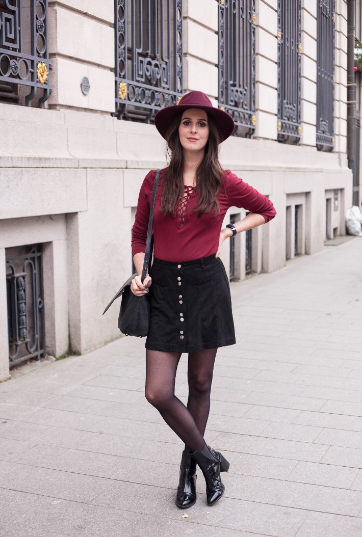 outfit: burgundy hat, lace up top, button down skirt and patent chelsea boots