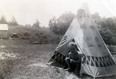 My father Chip Carlson peeking out of his play teepee