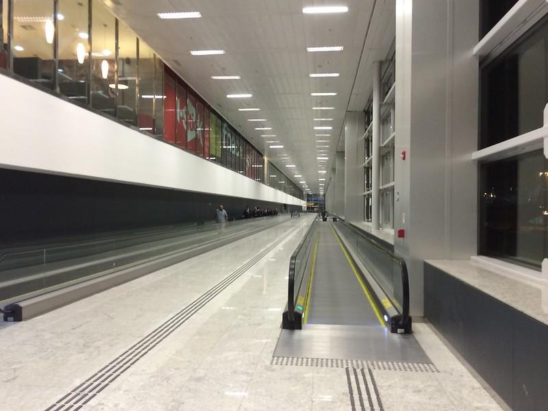 Multiple long moving sidewalks at São Paulo airport.