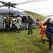 Sailors and Marines deliver food to the village of Jabouin. by Official U.S. Navy Imagery