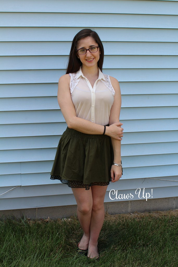 Olive skirt, nude button down top.