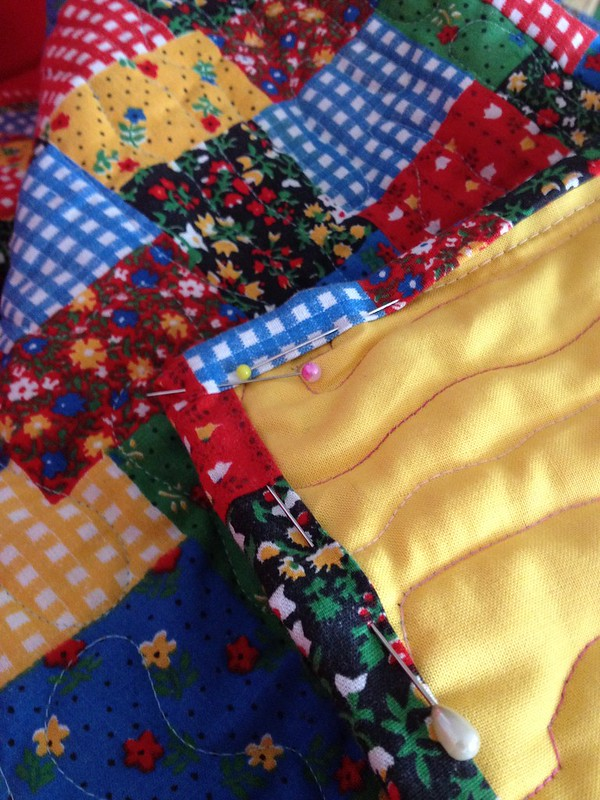 Adding binding to a community quilt