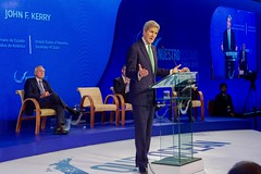 With Chilean Foreign Minister Alberto Nuñoz looking on, U.S. Secretary of State John Kerry delivers remarks at the Our Ocean Conference 2015 High-Level Segment in Valparaíso, Chile, on October 5, 2015. [State Department photo/ Public Domain]