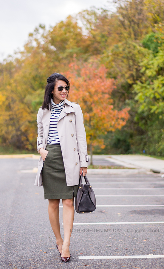 trench coat, striped turtleneck, olive green wool skirt, oversized watch, red pumps