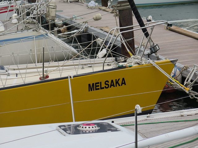 Melsaka, a smart yellow boat, docked