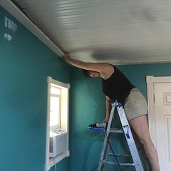 Jessica ward putting up trim in the guest room. #sustainableliving #artistresidency #habitablespaces #kingsburyfallfest