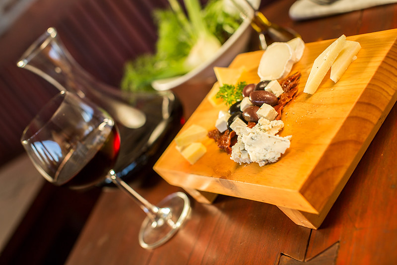 Cheese plate with a glass of red wine