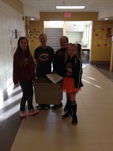 Students at Morningside Elementary help deliver food bags around the school.