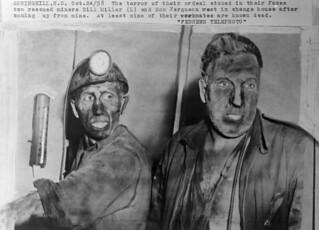 Mine disaster survivors Bill Miller (left) and Don Ferguson in change house after coming up from mine / Les survivants de la catastrophe à la mine, Bill Miller (à gauche) et Don Ferguson, dans le vestiaire, après leur sortie de la mine