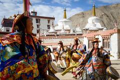 Buddhist monks during a dance ritual at Lamayuru Monastery.