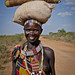 Peter Gostelow posted a photo:Kapoeta is dominated by the Toposa tribe. The tubular bundle on her head is tobacco, which is commonly smoked in large pipes.