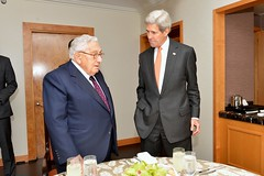 U.S. Secretary of State John Kerry greets former U.S. Secretary of State Henry Kissinger before their lunch in New York City on October 2, 2015. [State Department photo/ Public Domain]
