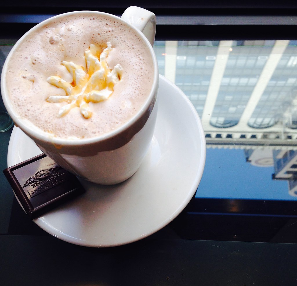 Sea Salt Caramel Hot Cocoa at Ghirardelli, San Francisco (Met Trust building in reflection)
