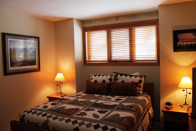 Master bedroom with queen size bed and full closet;