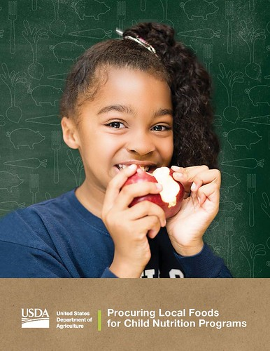 A girl eating an apple on the Procuring Local Foods for Child Nutrition Programs poster
