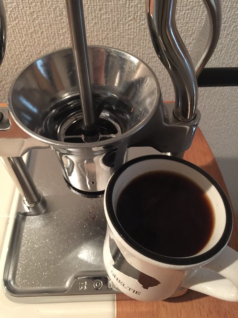 A cup of coffee and ROK Coffee Grinder