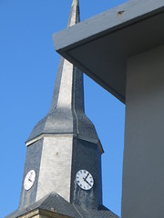 church bell(0.0), bell(0.0), bell tower(0.0), lighting(0.0), steeple(1.0), facade(1.0), blue(1.0), tower(1.0),
