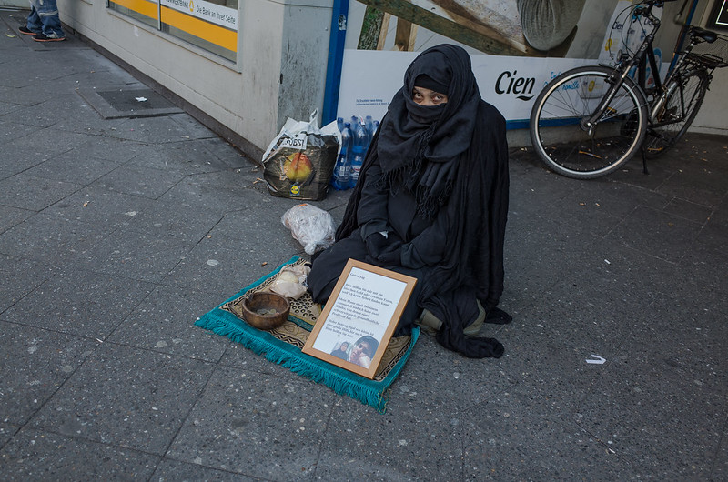 Looks Arab, speaks Romanian. Karl-Marx-Straße, December 2015.