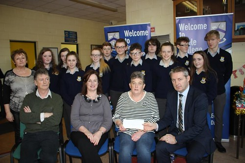 Jacqueline Hunter ,representing Presbyterian Hall, Raphoe accepting a cheque from principle, staff & students from Deele College