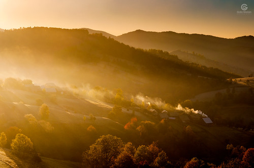 morning sunrise smoke mist trees bucovina romania hills houses village light shadows colors autumn fall sky landscape nature