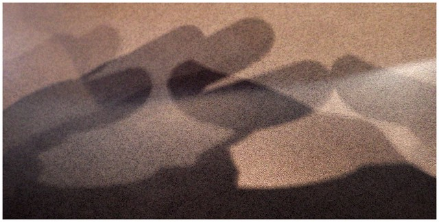 SHADOWS ON MY TABLE AT BURGER KING, AS I SIT WAITING TO BE CALLED FOR MY ORDER OF CHICKEN FRIES