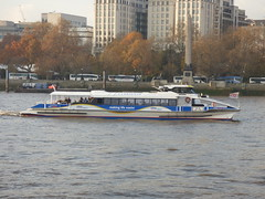 River Thames from the South Bank in London - boat - mbna - Thames clippers - Sun Clipper