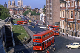 York Corp Bristol VRT-SL36-LXB VRT-SL3 FWR 218T (3721) Bristol VRT-SL3 6LX VRT-SL3 RWT 545R (fleet No 3970) and a Leyland National with Yorkminster Cathedral overlooking in Museum Street, York, England, United Kingdom.